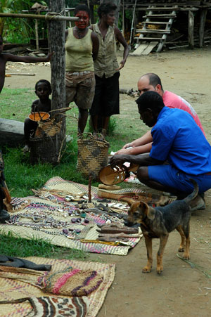 Impromptu crafts market - people come from around the world to collect Sepik wood carvings